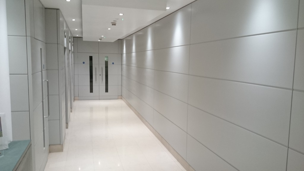 Lift lobby after spraying works by Ceilcote
