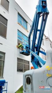 Onsite spray painting of aluminium window frames by Ceilcote.com