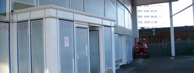 Curtain Walling Spraying by Ceilcote – 01733 558251 / 0207 519 6362